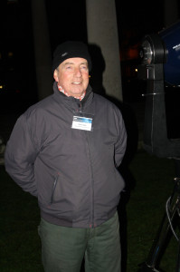 """Martin standing by his 10"""" Meade telescope"""