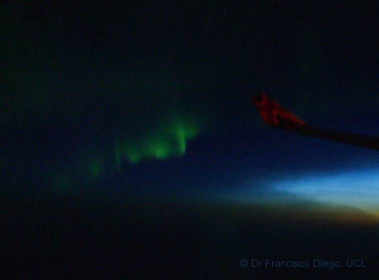 Noctilucent cloud and aurorae from an airplane window